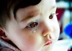 Kili sad baby image Oct2613doblelolcom-brneyes-hi-res