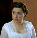 Margaret-isDanielaDenby-Ashe-inNorth&South-andpinkflowersApr0212wiki-crop-clr-hi-res-flip