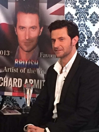 RichardArmitageReceiving-2013FavoriteBritishArtistAward_Mar0514TheAnglophileChannelFB-sized
