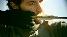 John-having-archery-practice-isRichardArmitage-atRobinHoodAcad16May2614ranet-sized-glovemanip