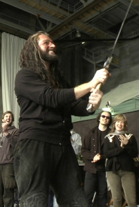 RichardArmitage-inThorin-costume-holding-up-his Orcrist-gift--Oct0714Nowhereinparticular-tumblr-sized-cntrst