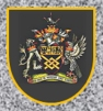 SirRoderick--MertonCoatofArms--lb_May0315wiki_sized-brt-200x213-onStoneWall