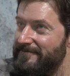 Sam-isRichardArmitage-inbeard-andPlaid-wHeadphones-smiling-in2015_Oct2115viaNoemi-sized-crop2