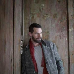 RAPortrait--2014--RichardArmitage-inPlaidCoat-leaning-against-wall-bySarahDunn_Jun0316SarahDunnFB