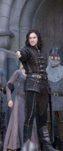 sirguy-rh3-guy-pointing-sword-wkate-held-prisoner-behind-him_jan0617viafabo